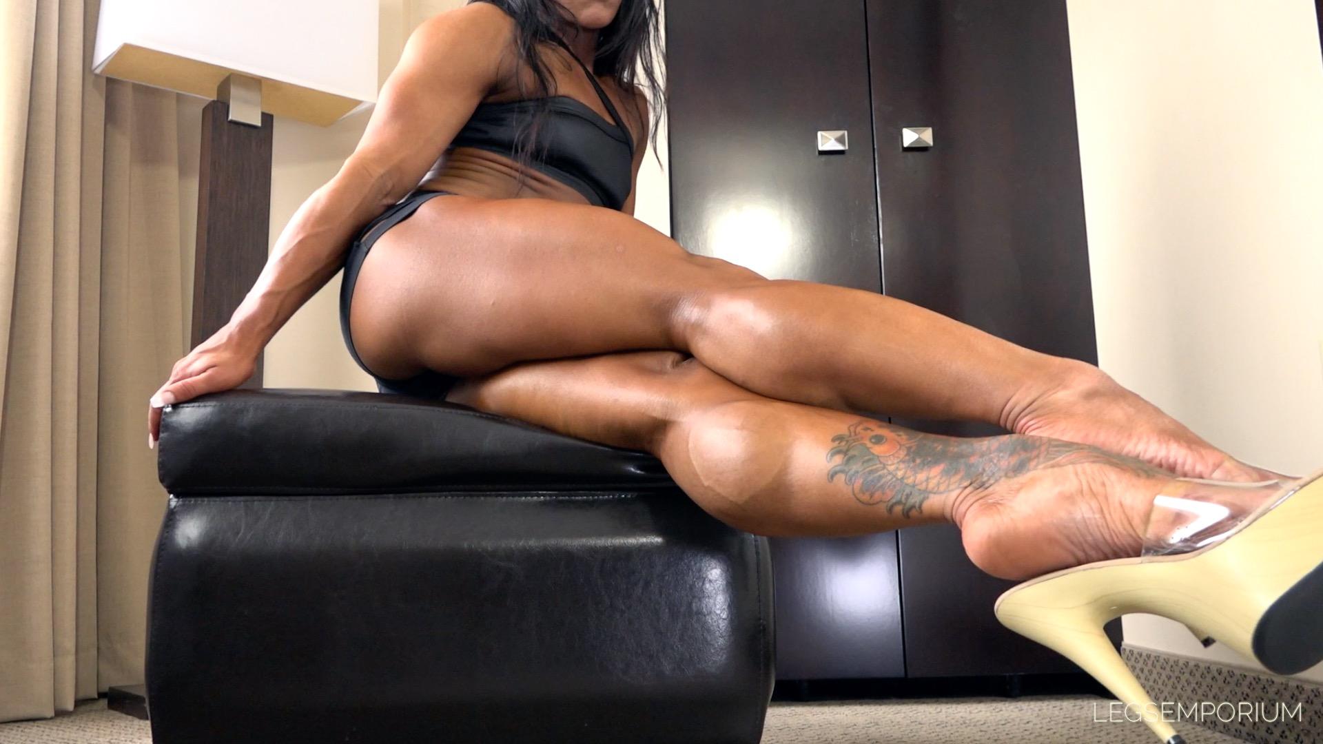 Hot muscle legs in black pantyhose and heels